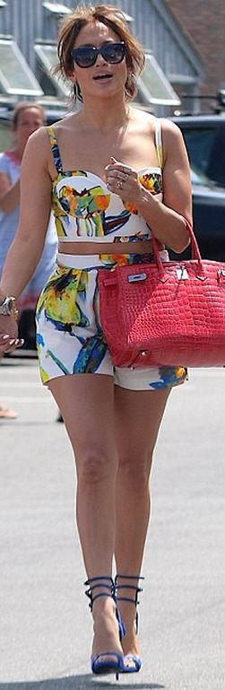 Jennifer Lopez: Sunglasses – Theiry  Shirt and short – Milly  Purse – Hermes