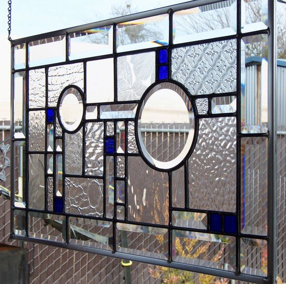 I designed and handcrafted this contemporary stained glass window using different types and textures of clear architectural glass with bevels and
