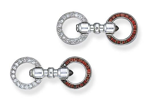 A PAIR OF ART DECO DIAMOND AND RUBY CUFF LINKS, CARTIER   Each double link set with a baguette-cut ruby opposite a circular-cut diamond circular link, joined by a bar link, mounted in platinum, (one ruby deficient), circa 1925, in a Cartier red leather fitted case  Signed Cartier, no. 2919776