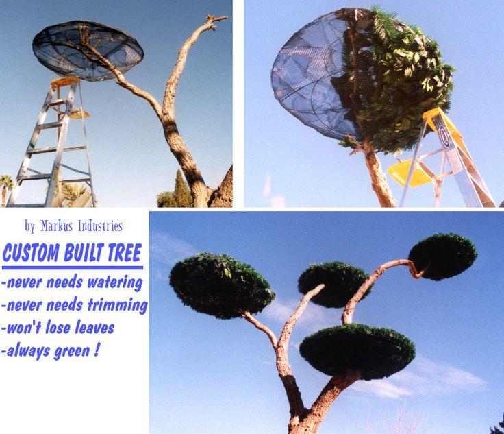 подделка елка из проволочной сетки и рождественские гирлянды.  Никогда потребности полива, никогда не нуждается обрезки, не потеряет листья, всегда зеленый!  Маркус Rothkranz Industries