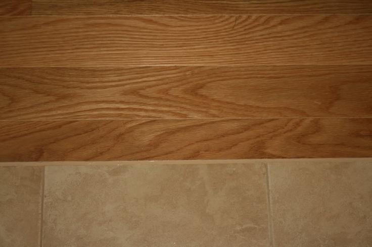 Porcelain tile floor next to hardwood floor used for Hardwood floors next to tile