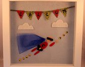 Superkid - handmade felt wall art in a wooden shadow box frame, personalised with mini-bunting