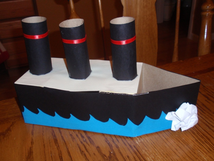 This is for the valentine box contest for my son's 4th grade class, so it had to be manly. We used a Kleenex box, scrap pieces of cardboard/cardstock and tp rolls to create the boat. Then decorated with cardstock/construction paper. My son is a big Titanic buff...the iceberg was his idea, as stated by original pinner.