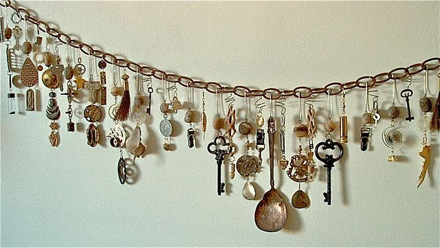 This blogger~~used found objects, handmade beads, stones and bones, clock parts, tools, horsehair and handcuffs, religious objects and discarded jewelry. It dangles from a rusty chain on her wall!  A chatelaine for the Modern Woman