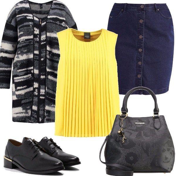 Per una giornata in ufficio propongo una camicetta gialla abbinata ad una gonna di jeans, cardigan con scollo a V, stringate a punta e borsa a mano con chiusura magnetica.