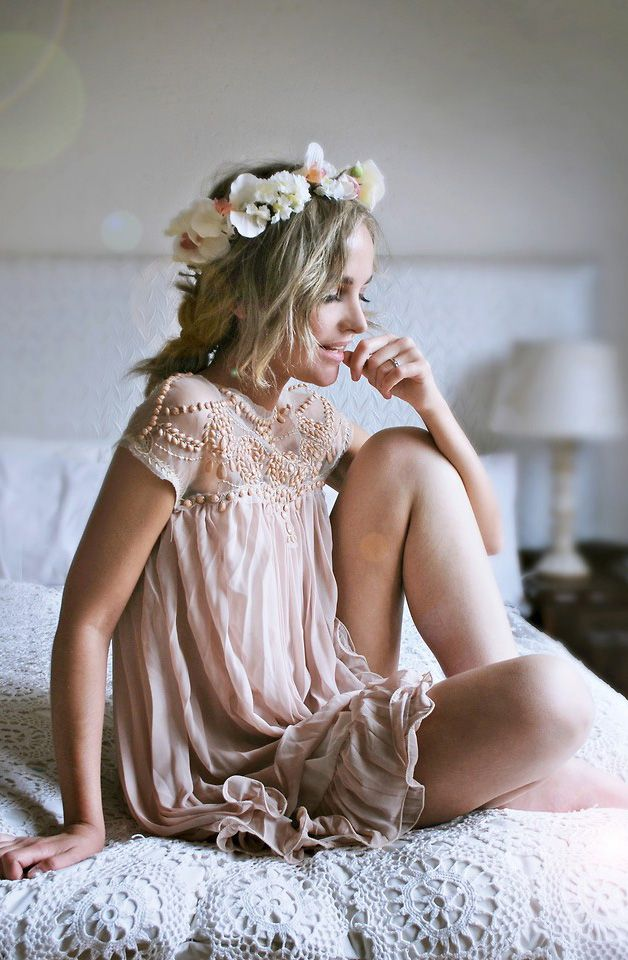 Embellished boho dress in blush pink colour with a floral head piece.