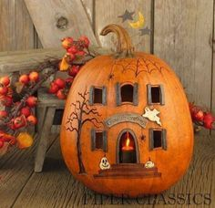 Haunted House Pumpkin...these are the BEST Carved & Decorated Pumpkin Ideas! = INSPIRATION ONLY -- Not that I would even try to make this one!