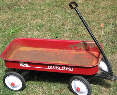 Fixing a rusty red wagon