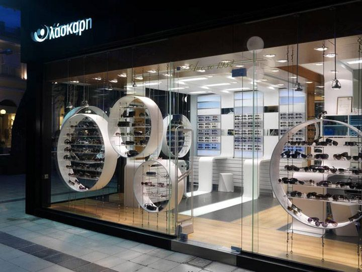 Love the hanging circles for display at Opticshop by Darch , Kifissia store design in athens