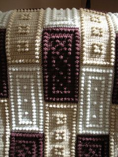 """This crocheted blanket is an original design that is easy to complete. The entire blanket requires only three crochet stitches - chain stitch, single crochet and the popcorn stitch. The pattern includes the instructions, a list of materials and the yarn amounts needed for a finished blanket approximately 48"""" x 64""""."""