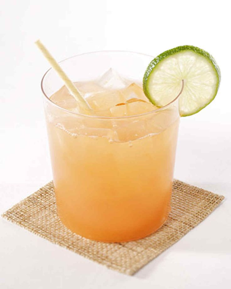 Rum Punch | Martha Stewart Living - Four different fruit juices and light rum make a sweet-tart, refreshing punch. A little bit of grenadine gives the drink its pink blush.