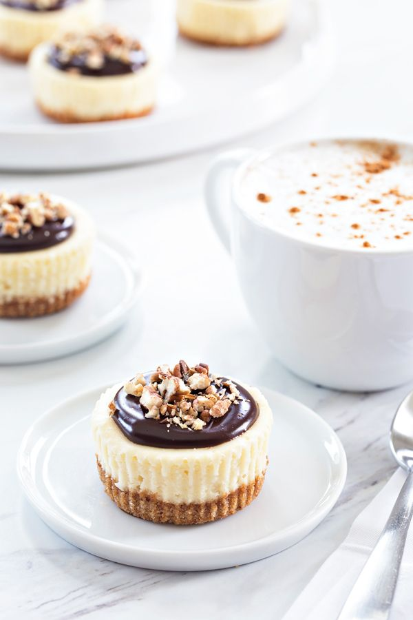 Mini Chocolate Pecan Cheesecakes will cure any nutty chocolate craving you've got going on. They're perfect for your next dinner party, too. Sponsored by Karo Syrup.