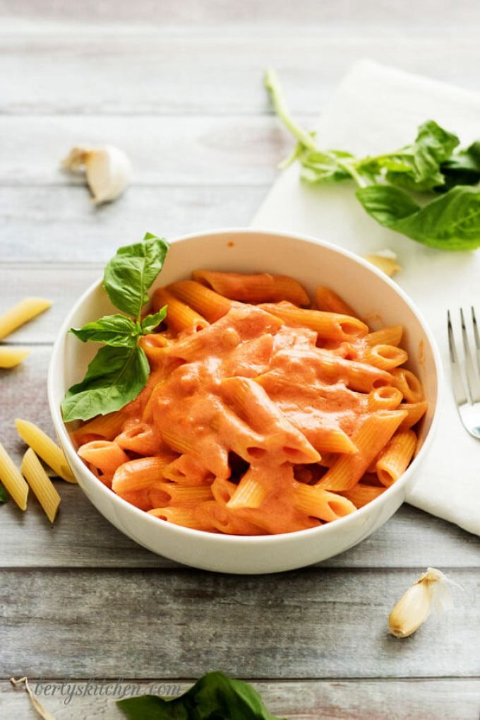 Penne Alla Vodka is the perfect blend of tomato, heavy cream, garlic, and onions simmered together to make a unique, pink sauce.