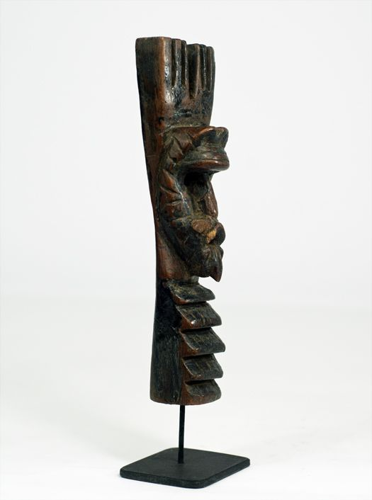 Title: Little Mask Totem #3367 Circa: Early 20th Century Description: Slingshot from Pacific Coast region, Guatemala. Materials: Painted hardwood. Dimensions: 5 3/4″ Price: $275.00 including shipping