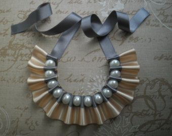 All my items are handcrafted. For this necklace I have used satin and grosgrain ribbons (in brown and ivory/beige) and white glass pearls. Every