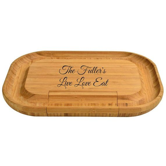 Personalized Cheese Cutting Board With Utensils Deluxe Then only the best will do, meet our bamboo cheese board set. This beautiful cheese board set with extra large area for cheese and appetizers that make it great for parties. This beautiful upscale entertainer hidden drawers that