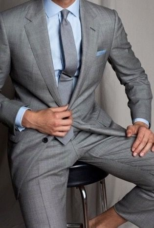 light gray suit with a blue shirt is a comfortable go-to look ...