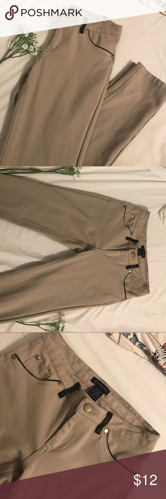Khaki Jeggings with Leather Details Khaki Jeggings with gold accents and faux leather details! Material is very stretchy and comfortable to wear! No flaws, in excellent condition 😊 Pants