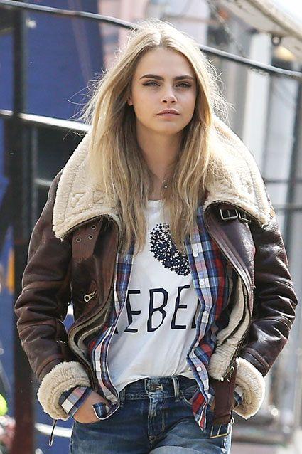 Brown leather sheep skin coat, white slogan tee + plaid shirt
