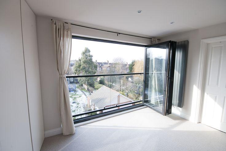 bifold glass doors and glas balustrade loft conversion NW london