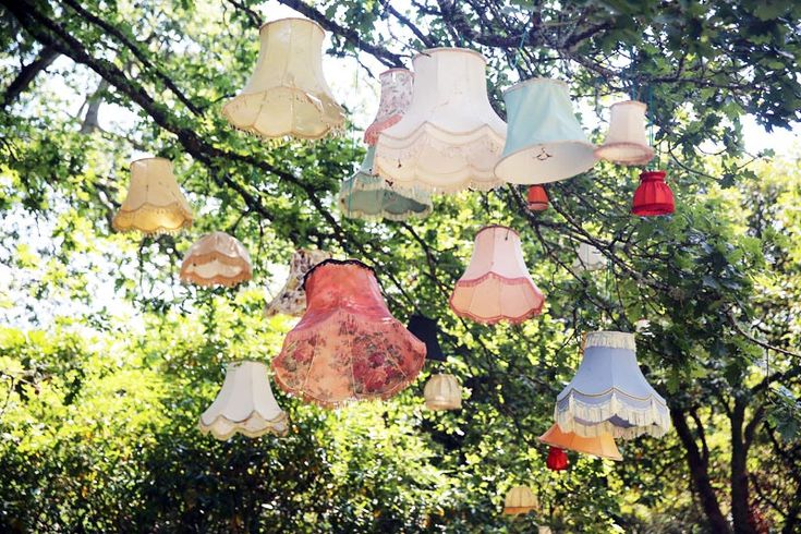 Vintage lampshades hanging from trees