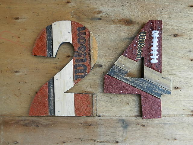 Perfect for the sports den: These numbers are made out of recycled wood, basketballs, and footballs!