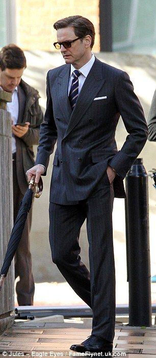 Coffee break: The 53-year-old British actor look dapper in a pin striped suit which he teamed with a navy blue and pink tie Dapper is a man's term.  Women would say OMG Hot!!