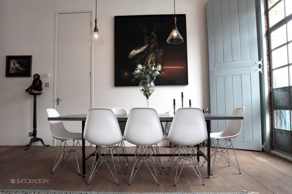 Dining room.  Wood floors, vitra chairs, french glass lights.  SHOOTFACTORY: london apartments / Trafalgar, london e9
