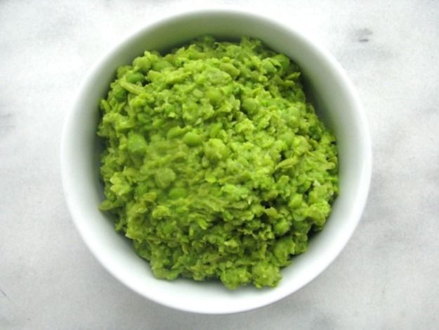 To many of us, the idea of serving any vegetable mushy conjures up images of sad canned string beans, and overcooked carrots.  Mushy peas are miles away from both of those dishes—peas are cooked simply with butter, then mashed and seasoned with lemon, salt and pepper.