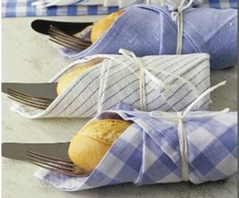 wrap fresh roll w/ silverware in a coordinating napkin, secure w/ twine