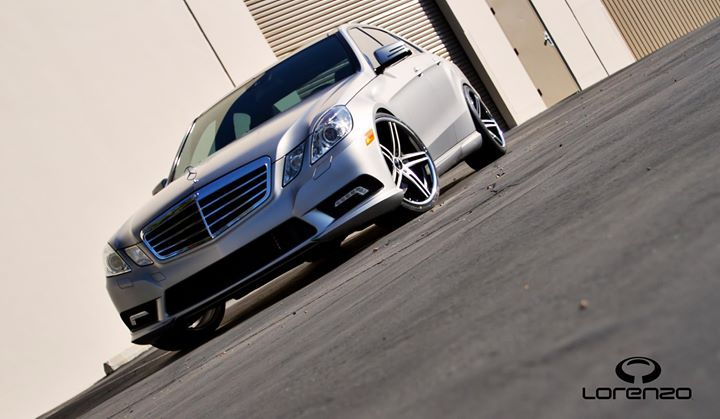 Silver Mercedes E350 with Satin Black Machined Face and Chrome Lip Lorenzo WL197 Wheels.  Staggered 20 Inch WL197 Rims. 20x9 Front and 20x10.5 Rear with Nitto Invo Tires 245-30-R20 & 295-25-R20.