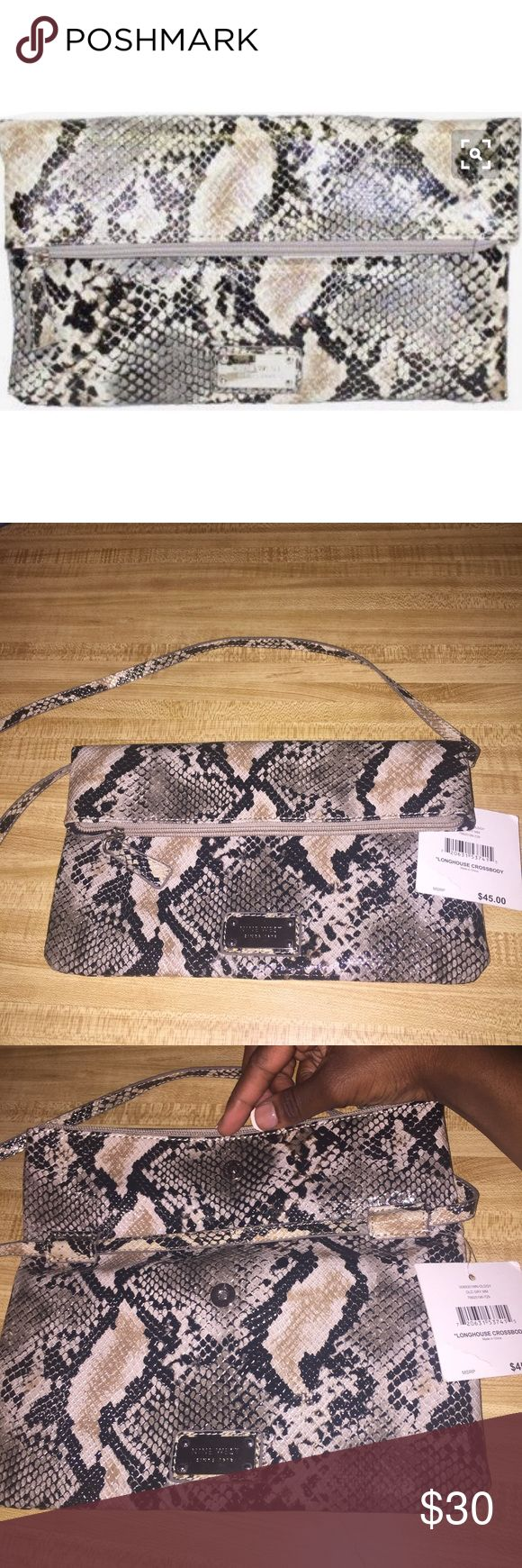 Snakeskin Crossover Bag This is the nine west longhouse crossover bag in color old gray. It's new with tags. Never used it but it's truly beautiful. The strap is removeable so it can also be used as a clutch. It's in perfect condition, open to offers 😊             Search Tags: Betsey johnson, kate spade, forever 21, f21, jessica simpson, vs pink, victoria's secret, juicy couture, dooney bourke, coach, michael kors, old navy, american apparel, urban outfitters, leather, monogram, purse…