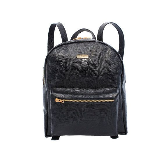 Make a statement in your off-duty repertoire with this black backpack from MONAO. Crafted with lizard pattern embossed leather catches all fashion