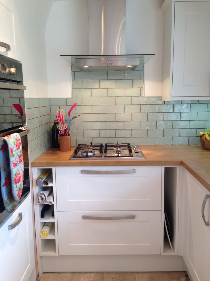 New kitchen; Laura Ashley tiles, Burford White Howdens Kitchen and brushed steel handles...