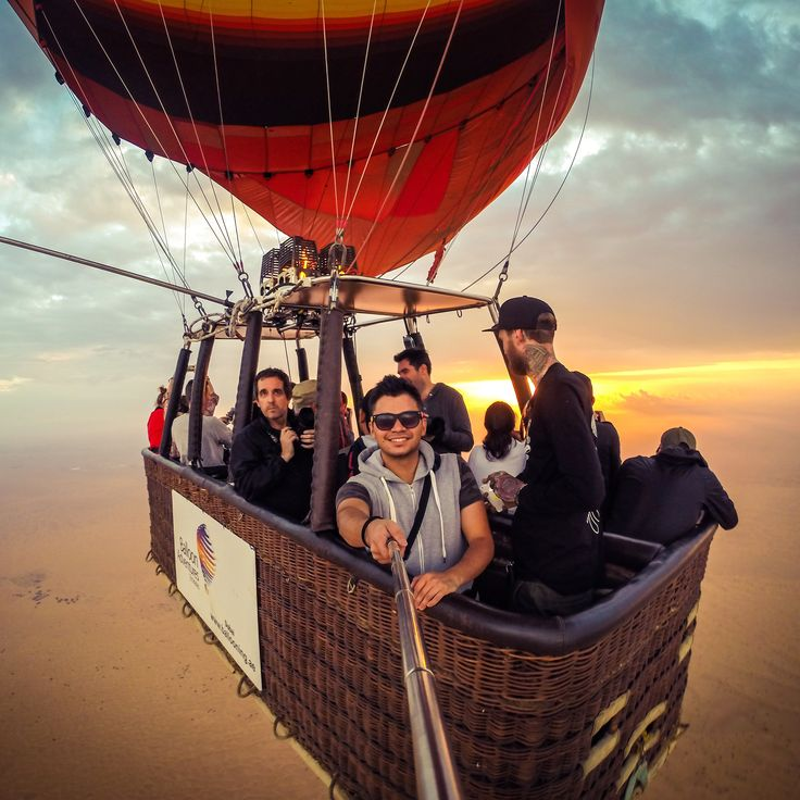 Going up in a hot air balloon is well worth the early start. Taking off at sunrise, you'll see the sand glow in golden hues until you're floating 1,200 metres above the dunes.