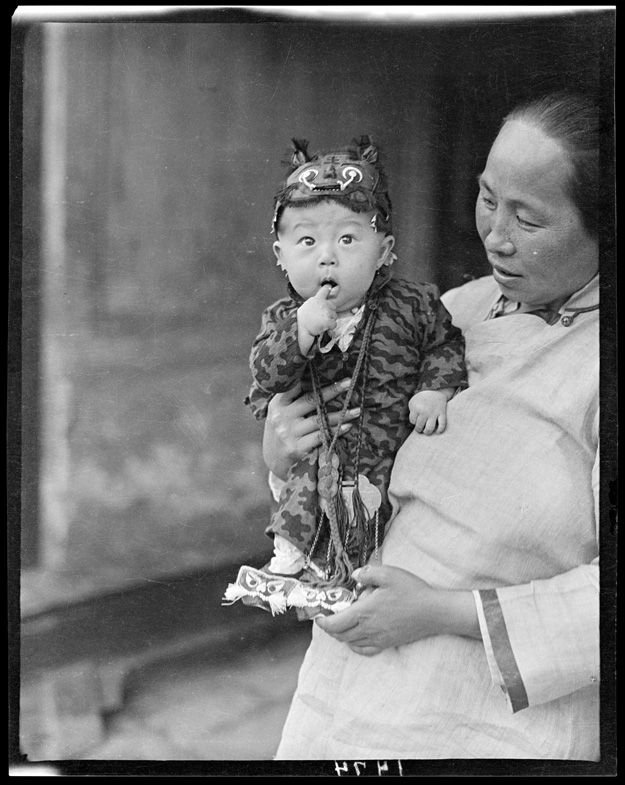 A photograph from renowned sociologist Sidney Gamble taken in the early 20th century will be on display depicting a small child in a tiger costume. Traditionally striped costumes were worn to frighten off evil spirits. Even today in China, children are dressed in tiger costumes for protection and to bring health, wealth and happiness the wearer. 1917