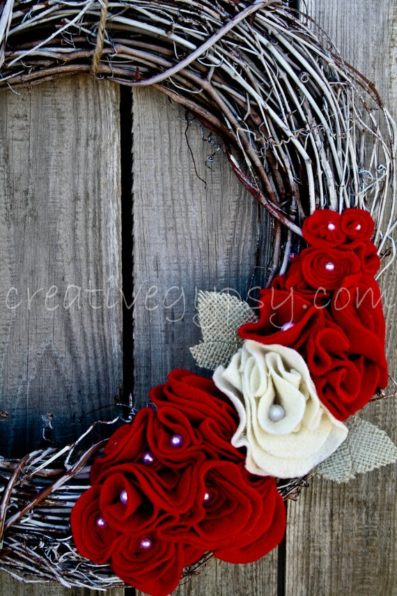 I pinned this to give you an idea of a color palet. I would like to add some soft yellows, or bright greens, to make it feel less winter, and more summer! Red and Ivory Felt Flower Wreath With Burlap