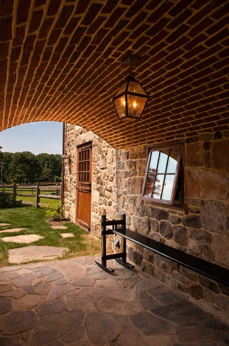 Au Soleil d'Or Farm's curved brick entryway transports visitors and redirects their thinking... you feel as though you are leaving the outside world and all your stress behind as you enter the stables.