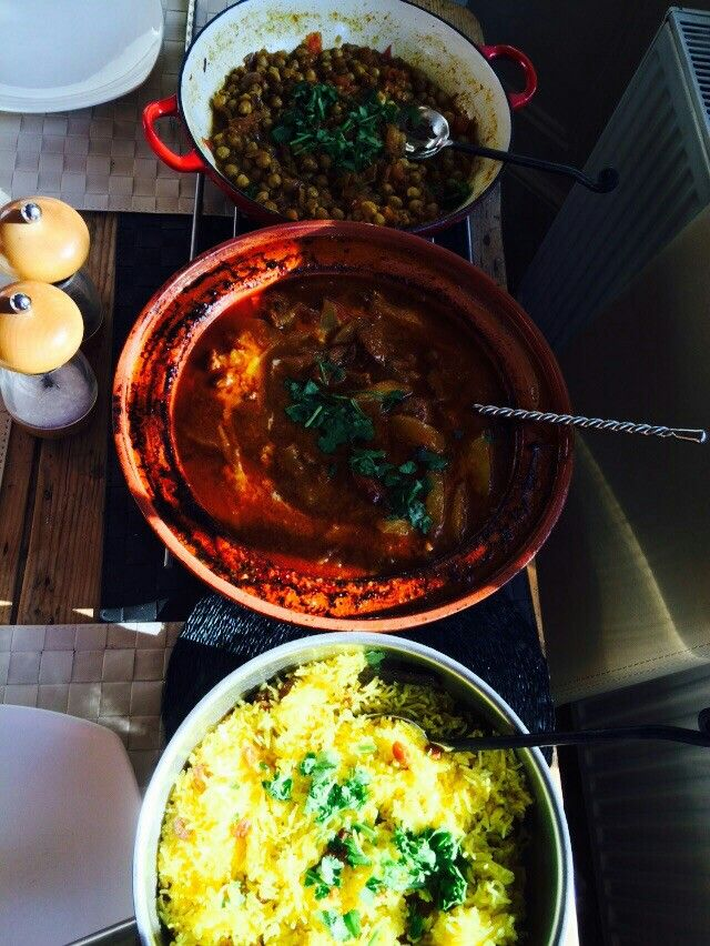 Lamb & Mango Curry, Chickpea Curry & Yellow Rice with raisins.