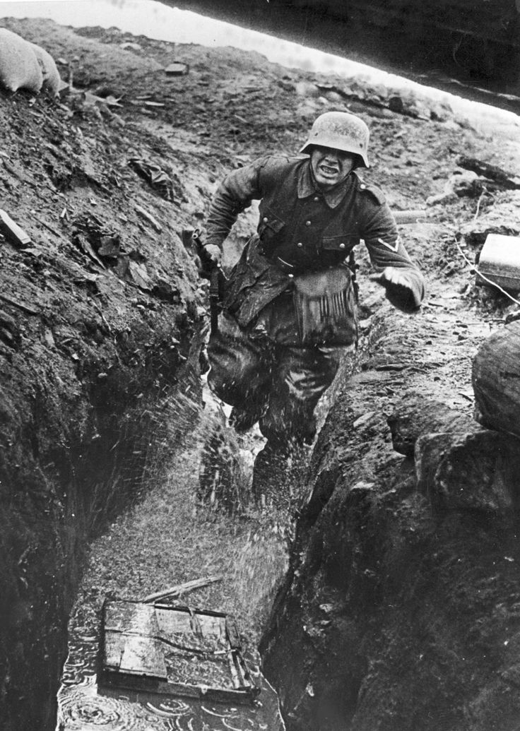 German messenger in wet trench, Eastern Front. Run for your life.
