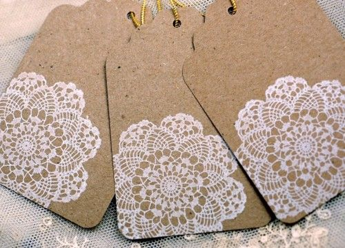 Kraft tags w/white ink—love!    {what i plan to do with the couples' kraft notebook favors - stamp their logo on the cover using white ink! love!}