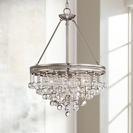 Offering classic elegance, this contemporary crystal chandelier comes in a brushed nickel finish.
