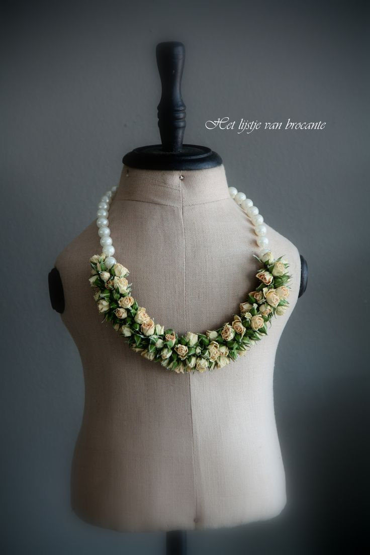 Dress form with home made flower necklace.