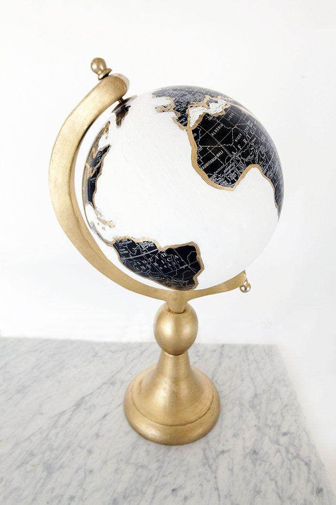 One trendy home decor item I have recently noticed, and fallen in love with, is painted globes. They are the perfect book shelf styling piece and can add character to add table or space. Despite loving the painted globes from places like Anthropologie, I just cannot bring myself to... #decor #diy                                                                                                                                                     More