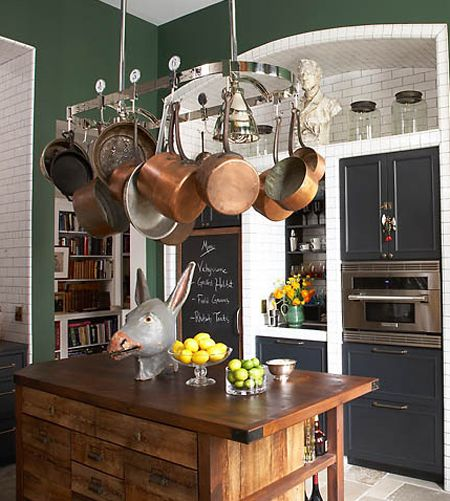 Gorgeous weathered Kitchens & Sky-High Subway Tiles. Dark green walls make a similar statement in the kitchen shown above, without the pain and commitment of repainting cupboards and cabinets. The formula seems pretty simple: dark green + brass + weathered wood + copper pots. Easy enough, right?