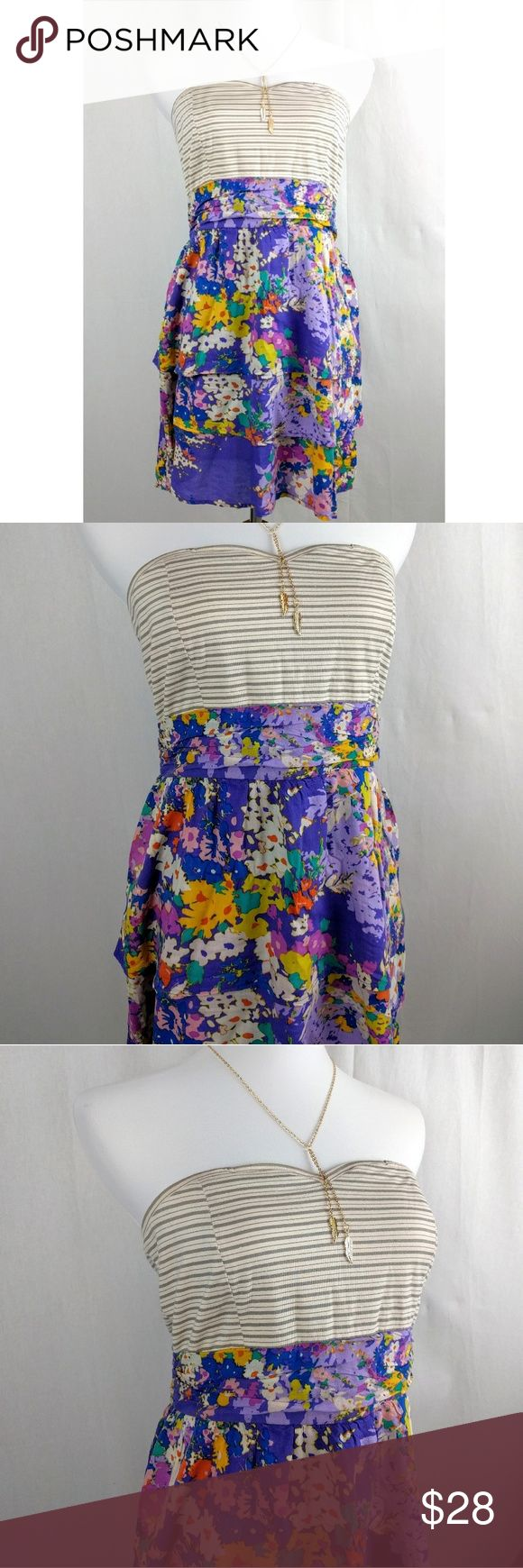 """O'Neil Spring Floral Stripe Soft Surf Dress O'Neill Floral Stripe Spring Dress. Super soft and comfortable surfer brand. Striped strapless top in ivory and grey. Ruched waist. Layered Flowy skirt. Purple, lavender, orange, yellow, blue, ivory, mint. Zip back. Size 9. Perfect for the beach or a cruise vacation. Excellent condition, no signs of wear. 100% Rayon. Length- 27"""" Bust- up to 36"""" (with stretch) Waist- 30"""" (no stretch) Hips- up to 42"""" Necklace also available. No trades, offers…"""