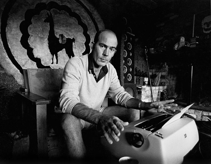 """americanphoto: © Michael Ochs Archives/Getty Images Hunter S. Thompson sits at his typewriter at his ranch near Aspen Colorado, c. 1976. From: Hunter S. Thompson's 1962 Pitch to Pop Photo on """"The Virtues of American Photography"""""""
