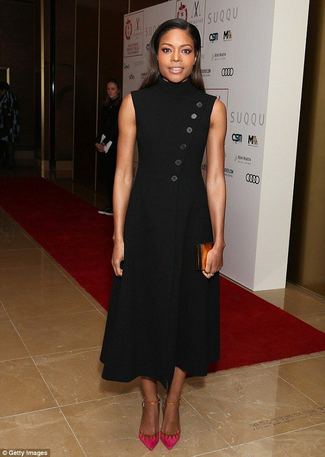 Chic: Contrasting Kate's choice of ensemble, Naomie Harris stepped out in a black gown