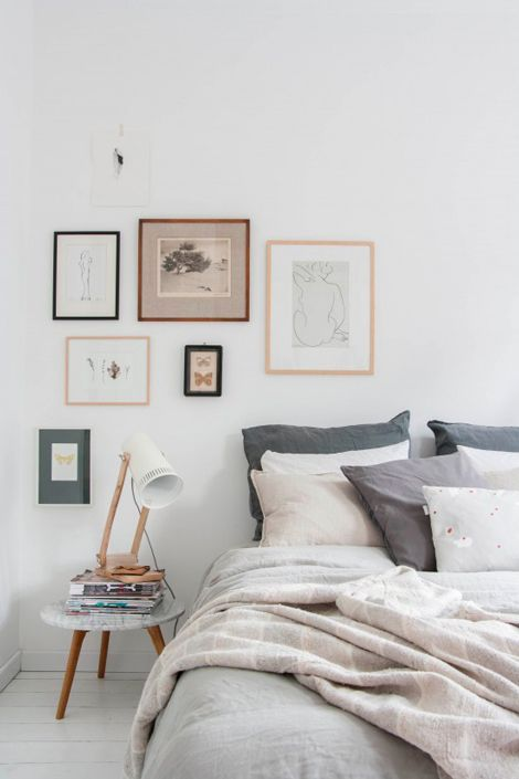 White and grey bedroom - beautiful picture framing!