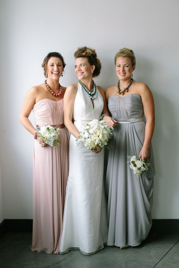 long bridesmaid dresses and chunky necklaces - photo by Caroline Ro http://www.ruffledblog.com/charity-inspired-wedding-ideas/